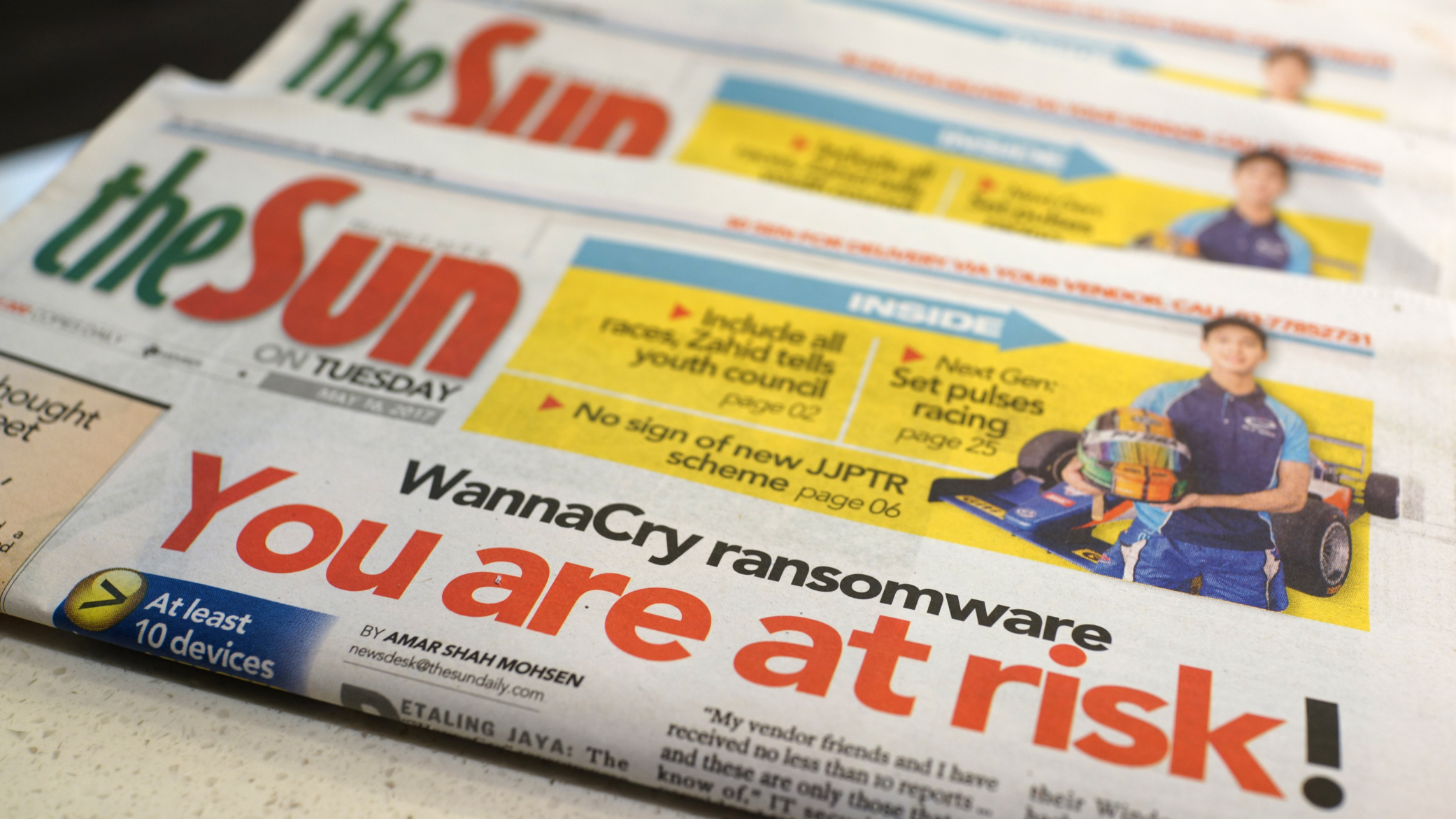Newspaper with cybersecurity headline