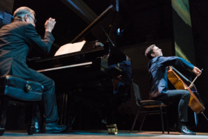 Pianist and cellist on stage.