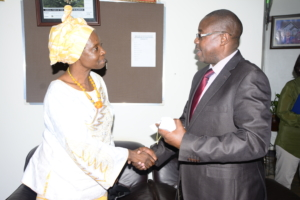 ACODE Acting Board Chair Josephine Odera with Wakiso district chairman Matia Lwanga Bwanika.