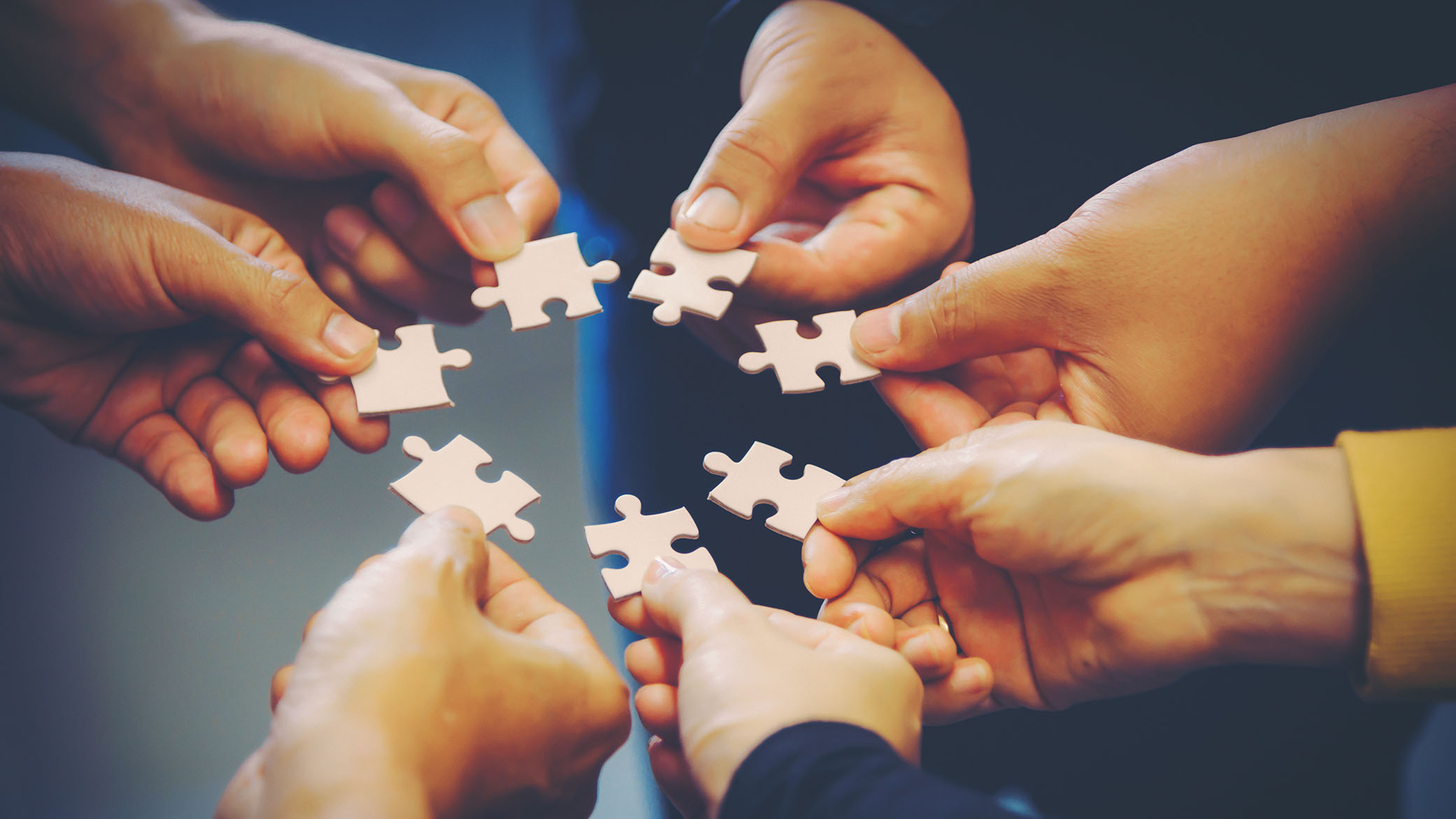 hands holding jigsaw pieces